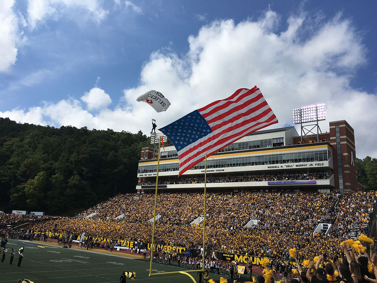 football event, football opening, american flag, flag show, skydive