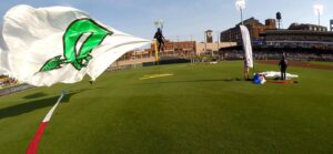 Team Fastrax™ member performs with a 2,000 sq. ft. Dayton Dragons Flag.