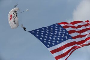 Team Fastrax member performs in the air with an American Flag