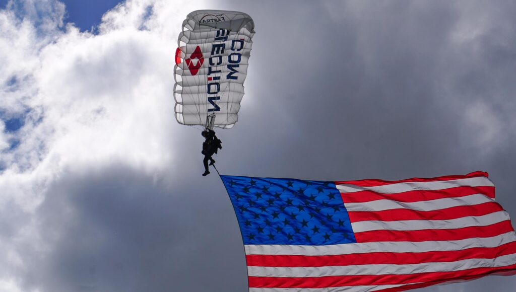 Team Fastrax™ member performs with a 2,000 sq. ft. American Flag.